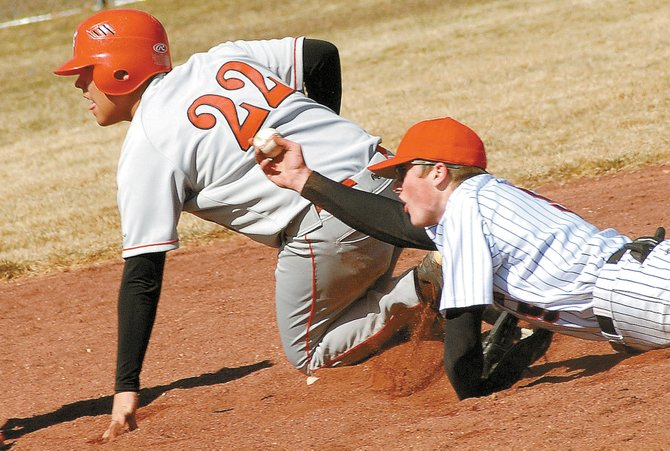 Glenwood Springs runner Mario Gonzalez, No. 22, is safe at second as Steamboat's Elliot Girard holds up the ball in Saturday's doubleheader at West Glenwood. Steamboat won the first game, 5-3, in eight innings. Glenwood won the second game, 22-7, in five innings.