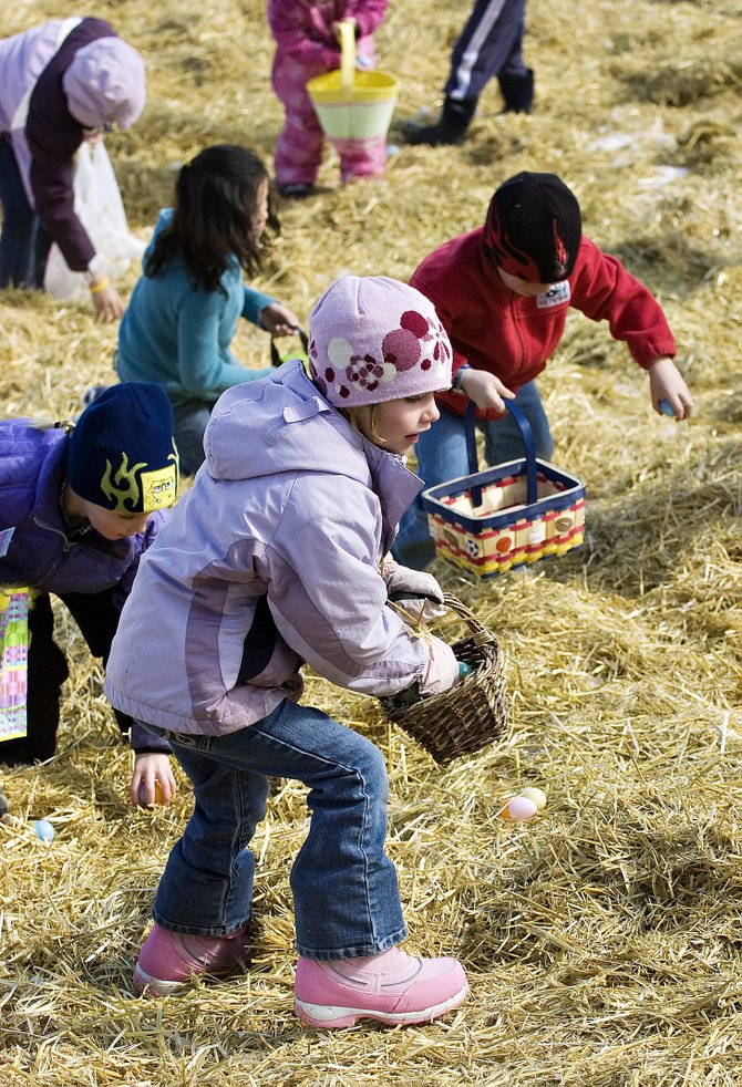 Sophie Leeson, 6, scrounges for plastic eggs at the annual Easter Egg Hunt at Howelsen Hill in Steamboat Springs on Saturday morning. Volunteers hid more than 5,000 eggs this year for children to collect.