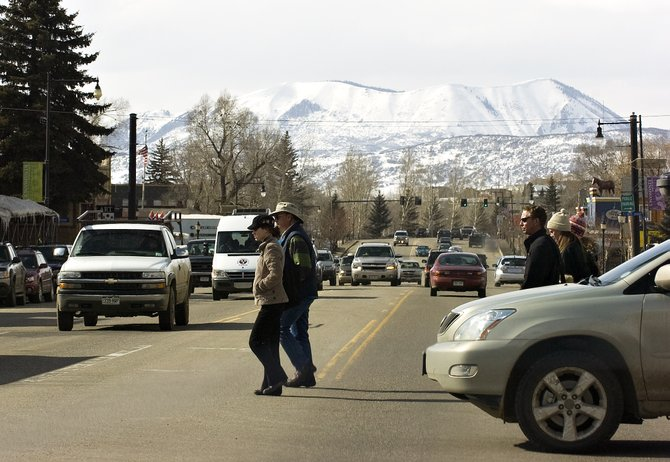 Pedestrians make their way across Lincoln Avenue in downtown Steamboat Springs on Friday afternoon.