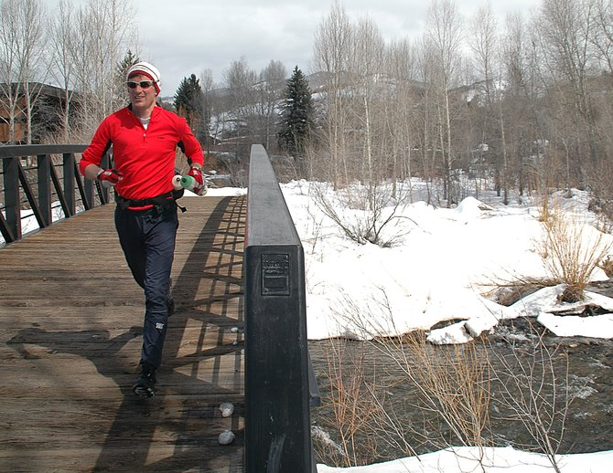 Steamboat resident Allen Belshaw runs across a bridge over the Yampa River on Friday while getting in three hours of training. Belshaw plans to run in a 50-mile race in June, then a 100-mile race in September.