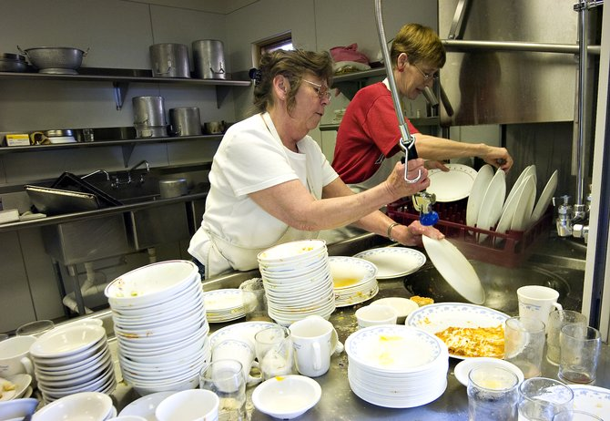 Peggy Dunning, left, and Lavon Cheek make use of the kitchen facilities to wash dishes after lunch at the new Steamboat Springs Community Center on Monday afternoon. Senior lunches are Mondays, Tuesdays, Thursdays and Fridays.