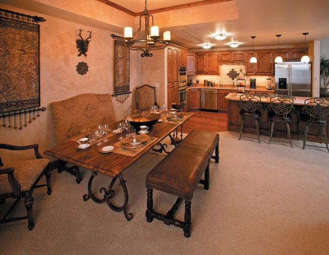 A dining and kitchen area inside a condo at the Highmark Resort at the base of Steamboat Ski Area. Pam Vanatta of Prudential Steamboat Realty confirms that the plan is to offer a high-end boutique hotel opening in June.