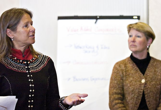 Lyn Halliday, left, and Sandy Evans Hall lead a discussion with local business owners about ways to expand and improve the Steamboat Springs Chamber Resort Association's Sustainable Business Program at Rex's American Grill & Bar in Steamboat Springs on Thursday afternoon.