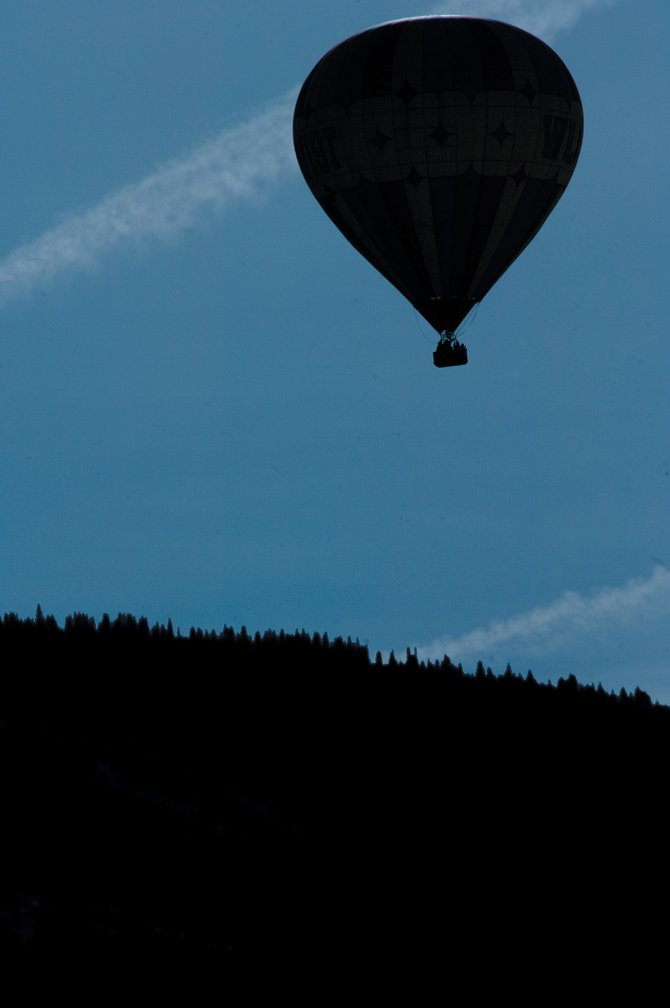 A balloon travels through the sky during the 27th annual Balloon Rodeo in 2007. The rodeo is one of many popular attractions for summer tourists in Routt County, which could see a drop in summer sales tax revenue this year because of reduced spending that local government officials say could result from the downturn in the overall national economy.