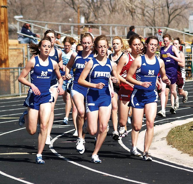Freshman Maddy Jourgensen, left, and junior Alicia Nelson sandwich two Fruita runners Saturday in the girls 800-meter run. Nelson won the event, and Jourgensen placed fifth.