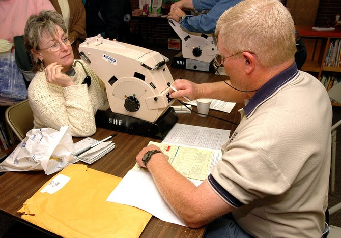 Craig Police Chief Walt Vanatta, right, a 9Health Fair volunteer, gives attendee Margaret Chipman, of Yampa, a vision test during the 2006 fair at Sunset Elementary School. This year's event is scheduled for 8 a.m. to noon April 19 at Sunset Elementary School, 800 W. Seventh St.