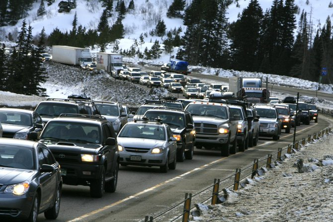 Traffic backs up on eastbound I-70 as skiers head out of the mountains after Presidents Day weekend this February. A state Senate bill proposing a toll for I-70 drivers has been met with scorn from Routt County officials.