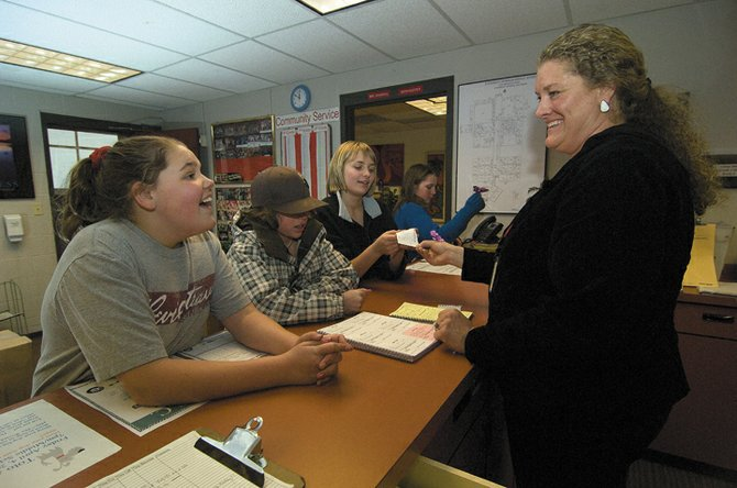 Office aide Aimee Weekslynn visits with sixth-grader Heather Seams on Wednesday afternoon in the office of the Steamboat Springs Middle School. Seam's classmates Kyla Taylor (plaid), Rachel Haslam (black) and Annastasia Bosley (blue) also are pictured. On Wednesday night, the Education Fund Board approved more than $3 million in funding requests, including up to $1.46 million for a Steamboat Springs Middle School renovation that would revamp the school's administrative and reception offices.