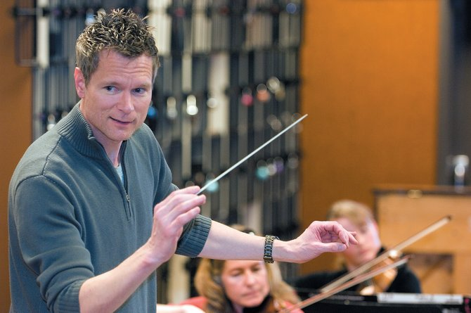 Ernest Richardson, music director of the Steamboat Springs Orchestra, works through a piece of music Monday evening during a rehearsal for this weekend's spring concert at the Steamboat Springs Christian Center.