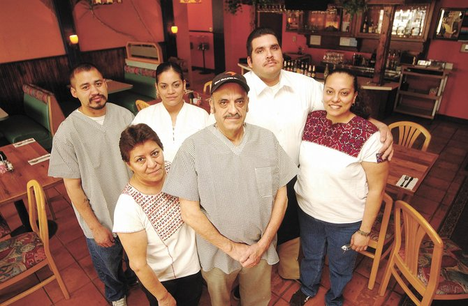 The Quintero family owns and operates Quintero's Mexican Restaurant. Pictured are, front row from left, Carmen and Luis Quintero, and, back row from left, Andres Cortez, Yara Quintero, Gabriel Clark and Metzeri Clark.