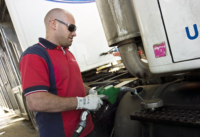 A B&K Distributing employee finishes filling the diesel gas tank on a commercial vehicle at the Petro West gas station in Steamboat Springs on Friday afternoon.