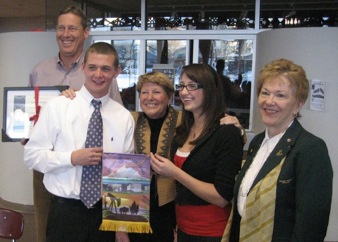 Steamboat Springs High School Principal Mike Knezevich, from left, Interact Vice President Matt McIntosh, Steamboat Springs Rotary Club President Sandy Evans Hall, Interact President Meghan Hanrahan and Rotary District Governor Nancy Pettus pose with the new Rotary Interact Club charter and banner presented at a special dinner March 31 at the high school.