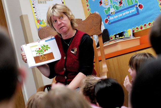 Susan Goodenow, Ridgeview Elementary first-grade teacher, gives a science lesson to her class Wednesday. Goodenow was appointed to the Colorado Council of the International Reading Association, a position she will assume in July. Her duties will include planning literacy programs and community literacy events.