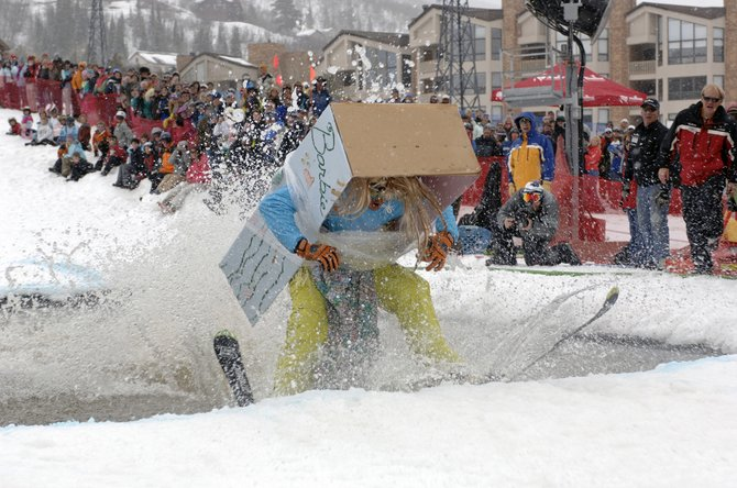Chris Ward, wearing his daughter's Barbie box costume, struggles to make it across the pond set up for the Splashdown Pond Skimming event Sunday at the base of the Steamboat Ski Area as part of closing day festivities.