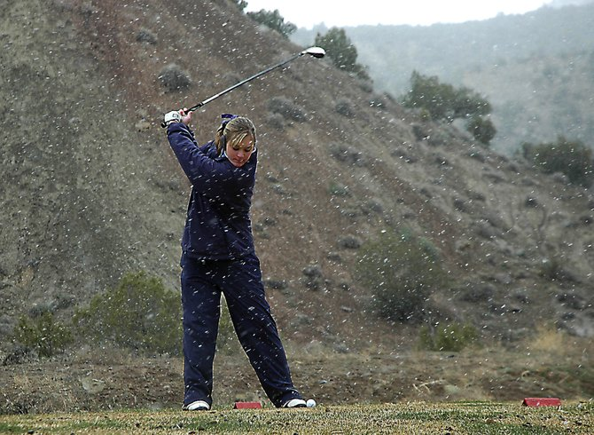 Moffat County High School senior Meghan Innes tees off Monday on hole No. 18 at Rifle Creek Golf Course. Innes placed second after a playoff in the snow-short