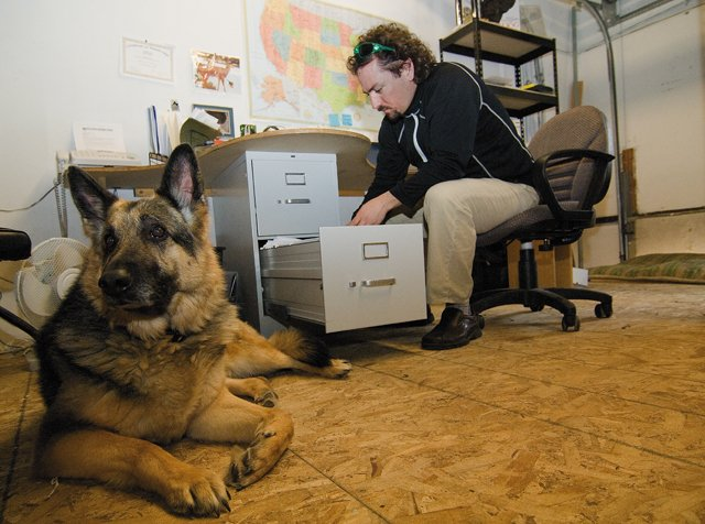 John Cardillo, who helped start Spiffy Dog Pet Products with partner Edward Watson, never has to leave his dog Alex at home when he goes to work. Alex and a pair of golden retrievers owned by Watson are fixtures inside the company's combined office, warehouse and retail outlet.