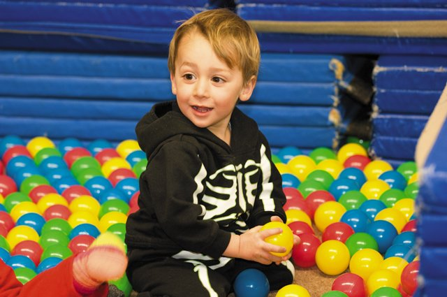 Mathais Radl-Jones plays in the balls during the Mom & Toddler Movement class taught by Robin Wilson at Colorado Mountain College. The class, for children ages 1 to 4, gives toddlers and mothers a fun and safe environment to grow stronger through movement.