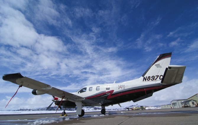 An airplane sits on the tarmac at the Steamboat Springs Airport on Monday afternoon.  Tonight's City Council meeting will include results from a study that says redeveloping the airport for other uses would be a money-losing venture for the city.