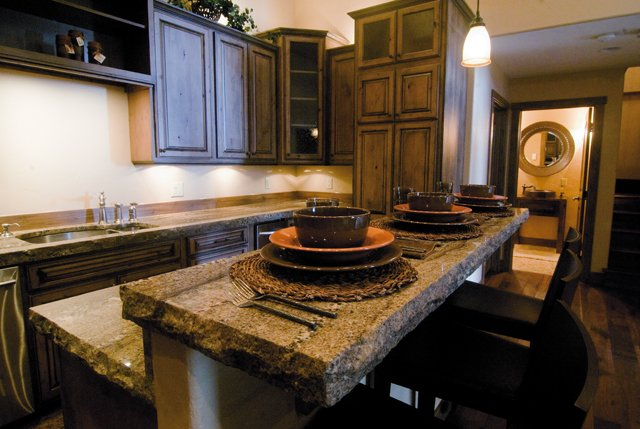 Besides top-end stainless steel appliances, the outstanding feature of the kitchen in this condo in Fox Creek Village is stunning granite counters that appear to be 5 centimeters thick and faced with rough chiseled edges.