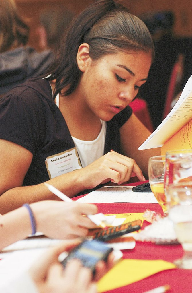 Eighth-grader Lucia Banuelos participates in an exercise Tuesday during the Girls to Women Conference at the Steamboat Grand Resort Hotel.