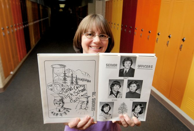 Vicky Slaight, Class of 1978 Reunion committee member, holds her 1978 yearbook in the halls of what used to be Moffat County High School. The building now is Craig Middle School.