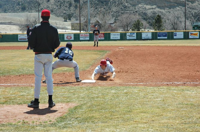 Steamboat Springs' Cody Harris slides back into first base Saturday in Rifle. Steamboat won the first game of the doubleheader, 10-7, before losing the second game, 18-10.