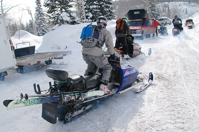 Aryeh Copa rides his snowmobile behind a pack of friends Saturday morning at Buffalo Pass. Copa said he's a regular at the area, preferring to go in the afternoon when the crowds have thinned. However, Saturday morning's fresh snow meant he couldn't wait.