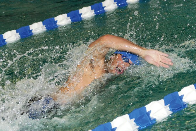 Cole Worsley competes in the 400-meter freestyle Saturday at Moffat County High School. Worsley won the 400-free and the 50-free, qualifying for state in the latter event.