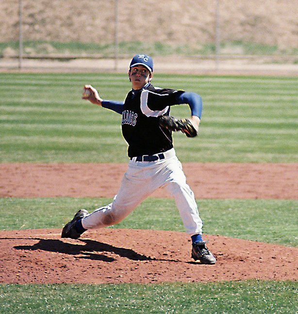 Moffat County High School pitcher Seth Lanier deals a strike Saturday against host Palisade. The Bulldogs split the road double-header, winning Game 1, 7-5, then dropping Game 2, 3-2.