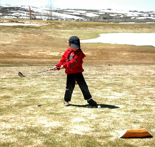 Craig youth Cort Murphy tees off on the 10th hole Monday at the Yampa Valley Golf Course. The 3-year-old is taking up golf under the encouragement of his father,