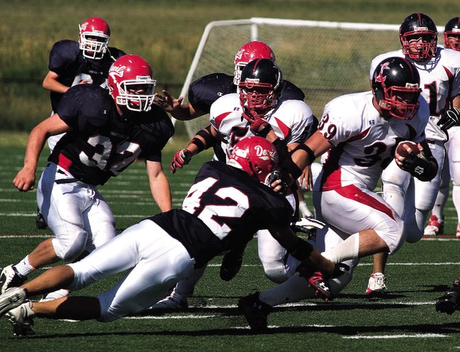 Jay Hanley, right, breaks through the pack against Kent Denver on Aug. 24, 2007. The Steamboat Springs High School senior has accepted a preferred walk-on spot with Kansas State University, an NCAA Division I program in the Big 12 Conference.