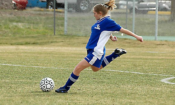 Moffat County High School soccer player Amanda Brewer takes a shot last week against Montrose. On Wednesday, The Bulldogs fell, 5-1, to host Rifle, but Brewer scored the team's first goal of the season.