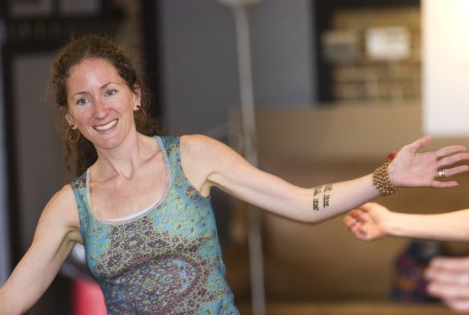 Nicole Idzahl warms up before rehearsal with her African dancing troupe at the Depot Art Center in Steamboat Springs on Tuesday evening.