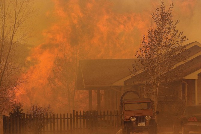 Flames explode behind a home Tuesday afternoon at the Ranch at Roaring Fork along Colorado Highway 82 in Carbondale. Disastrous fires also have struck southeast Colorado this week. Voters in rural areas around Steamboat Springs will decide in a mail-in vote, ending May 6, whether to increase property taxes to expand services of the Steamboat Springs Rural Fire Protection District.