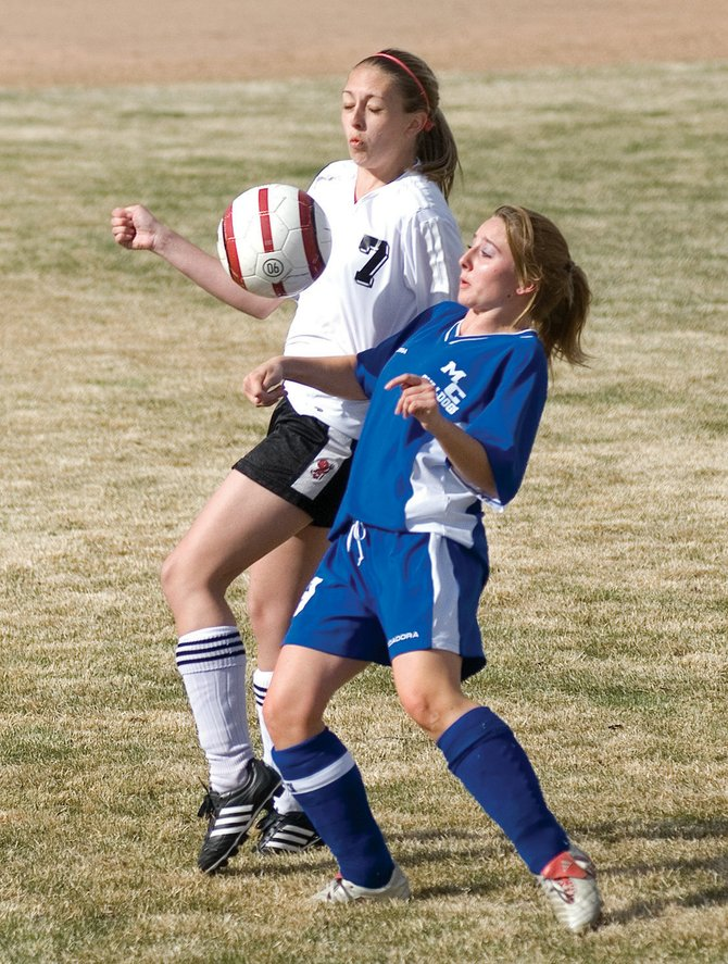 Eagle Valley's Annika Sandberg goes up for the ball against Moffat County's Samantha Ericksen during Thursday's game in Gypsum. The Devils defeated the Bulldogs, 5-1.