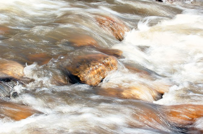 The chilly waters of Soda Creek were flowing quickly into the Yampa River on Monday morning as spring-like temperatures began cutting into this year's record snowfall.