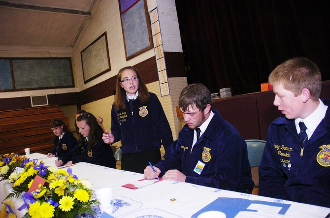 Members of the South Routt chapter of the National FFA Organization practice parliamentary procedure during a demonstration Thursday evening at Soroco High School.