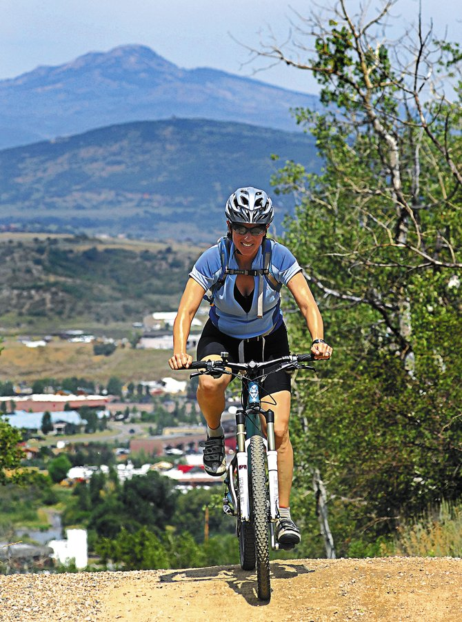 A mountain biker makes her way up Emerald Mountain two summers ago. This week, the Bureau of Land Management and the city of Steamboat Springs host meetings to discuss Emerald Mountain's recreational uses.