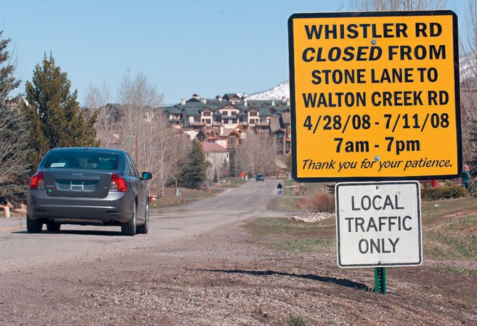 A sign on Whistler Road on Tuesday announces road closures beginning Monday and running through July. A $1 million project will replace 2,400 feet of water main in the neighborhood on Steamboat Springs' south side.