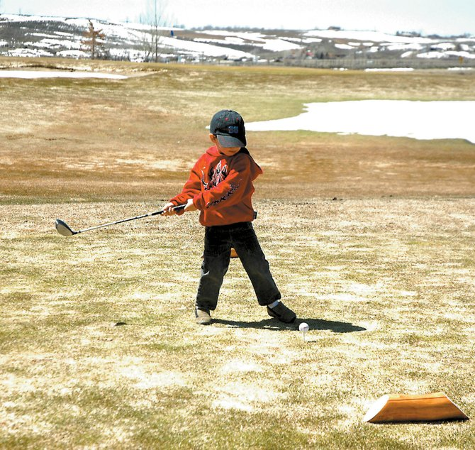 Craig youth Cort Murphy, 3, tees off on the 10th hole at the Yampa Valley Golf Course on April 14 in Craig. While no golf courses are open yet in Steamboat Springs, there are other options for local golf enthusiasts.