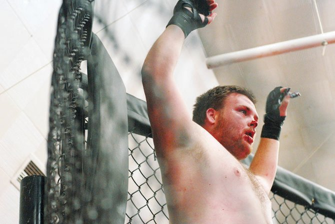 Chris Phillips raises his arms in November's Ultimate Cage Fighting event. Phillips lost to Jesse Caperton by second-round knockout.