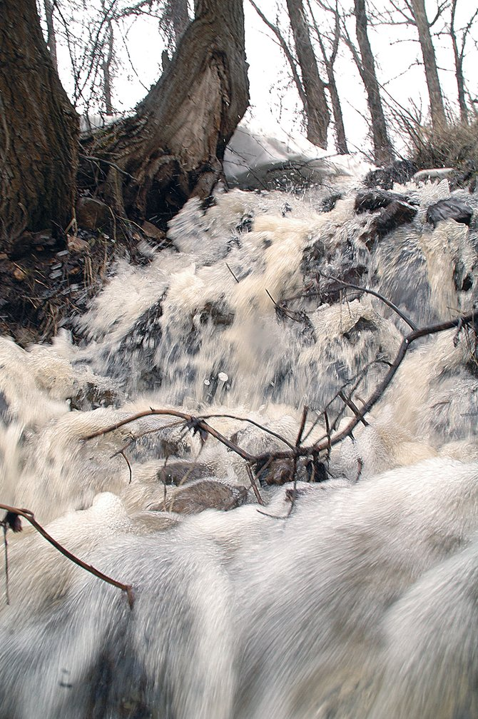 Snowmelt cascades down toward River Road on Wednesday before merging with the Yampa River east of Steamboat Springs. The Yampa is flowing above historic norms as the valley suddenly sheds low-elevation snowpack.