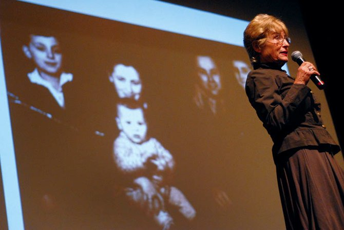 Susan Warsinger speaks Thursday at the Moffat County High School auditorium. Warsinger, a United States Holocaust Memorial Museum survivor volunteer, shared stories about her life and family during Nazi Germany.