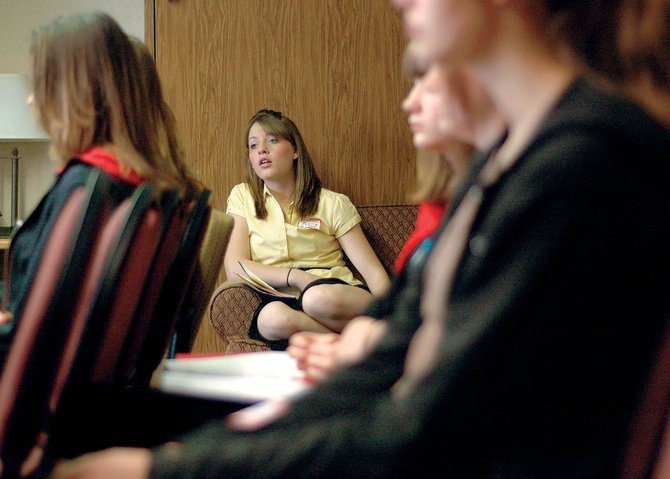 Adrie Camp, Craig Middle School eighth grader, listens to a presentation from Craig business owner Carol Jacobson, not pictured. The seminar was one of several at the Girls to Women, Women to Girls Career Conference on Thursday at the Holiday Inn of Craig.