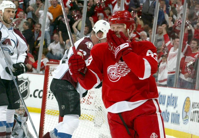 The Detroit Red Wings' Johan Franzen celebrates the third goal of the first period against the Colorado Avalanche. The Red Wings defeated the Avalanche, 4-3, during Game 1 of the NHL Western Conference semifinals Thursday at Joe Louis Arena in Detroit.