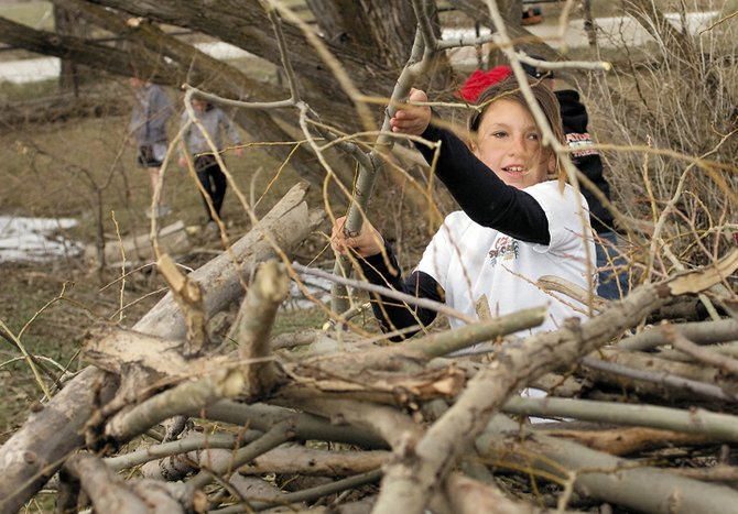 Hayden sixth-grader Sabatina Scura cleans up Hayden Town Park as a way of commemorating Arbor Day, which takes place today. The Hayden sixth-graders have made cleaning up the park an annual tradition.