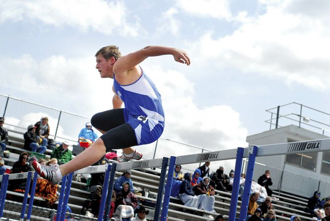 Moffat County High School sophomore Jeremiah Gordon leaps over a hurdle Friday in the Clint Wells Invitational at the high school. Gordon finished ninth in the boys 110-meter hurdles.