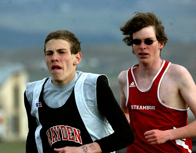 Hayden's Chris Zirkle, left, passes Steamboat's Gus Allen on Friday during the boys 3,200-meter run at the Clint Wells Invitational. Zirkle placed third, and Allen took eighth.
