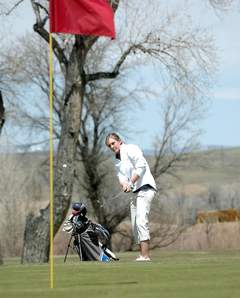 Moffat County High School senior Meghan Innes chips onto the 17th green Monday at the Yampa Valley Golf Course. The Bulldogs placed second in their lone home tournament of the season. Innes shot an 81, earning first place among 4A golfers.