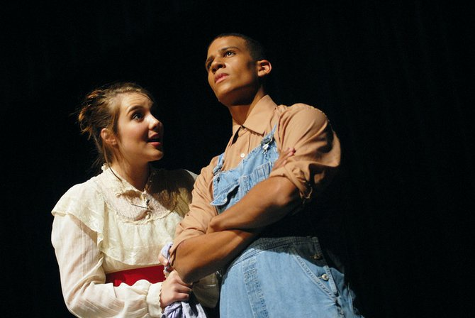 "Emily Norris, left, and Curtis Lorio act in ""The Lottery,"" one of three one-act plays presented at the Rock the Arts festival Tuesday at Moffat County High School. The event featured student-directed plays and choral and instrumental performances."